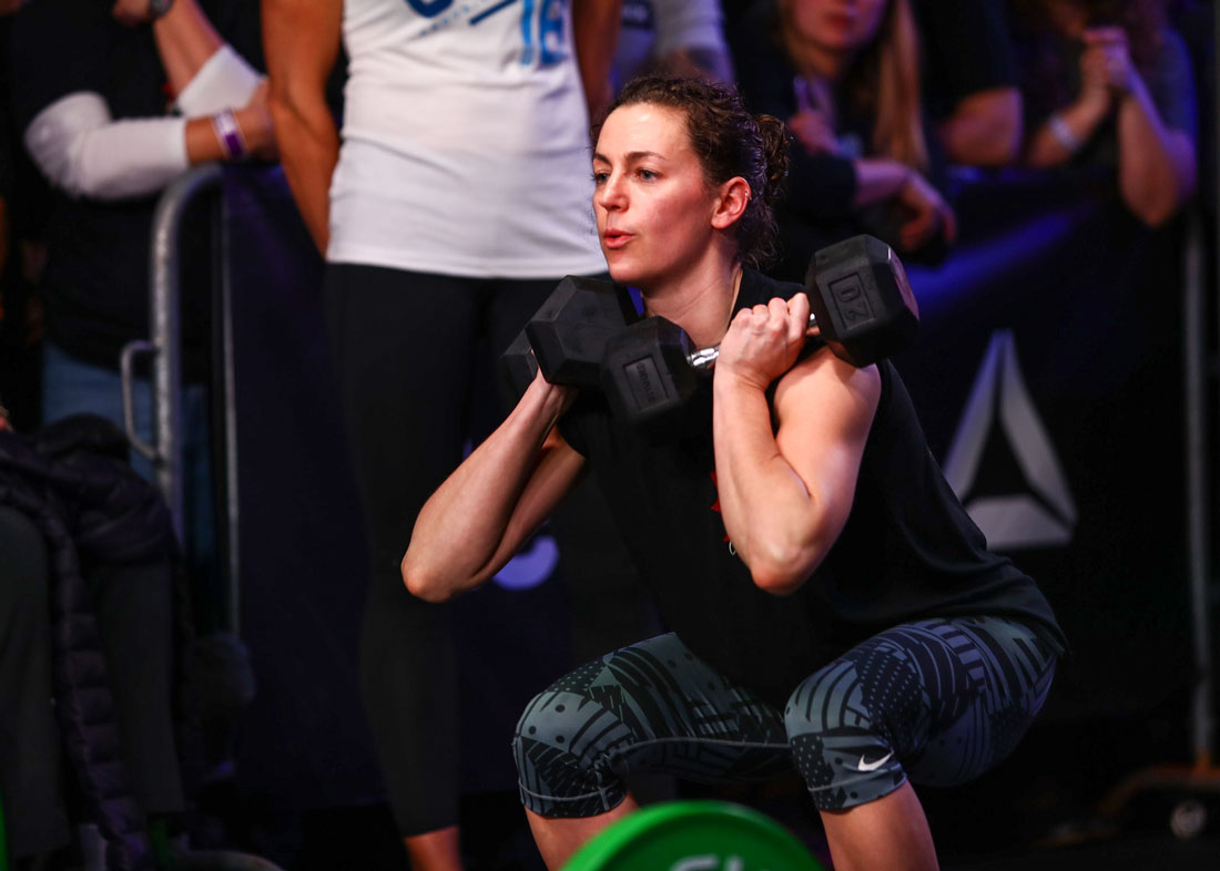 Lauren from CrossFit R.A.W. performing a dumbbell squat