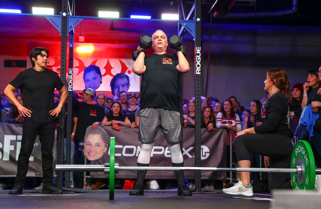 Bob from CrossFit R.A.W. performing dumbbell squat during 18.2