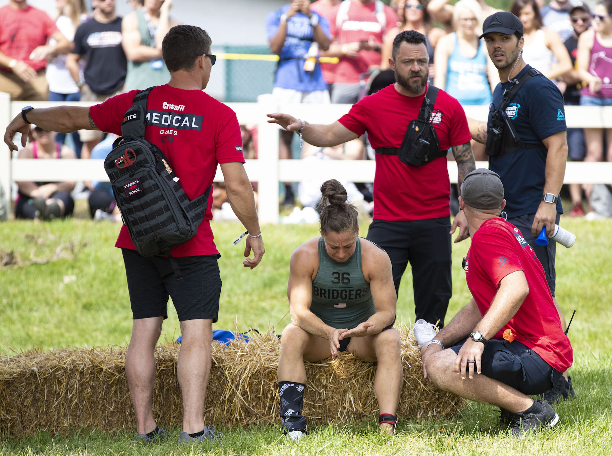 Emily Bridgers receives Medical attention after suffering an injury in The Battlegrounds at the 2018 Reebok CrossFit Games