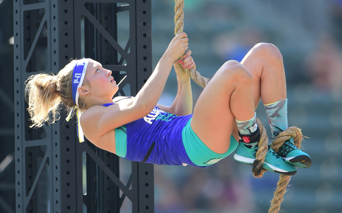 Haley Adams climbing rope.