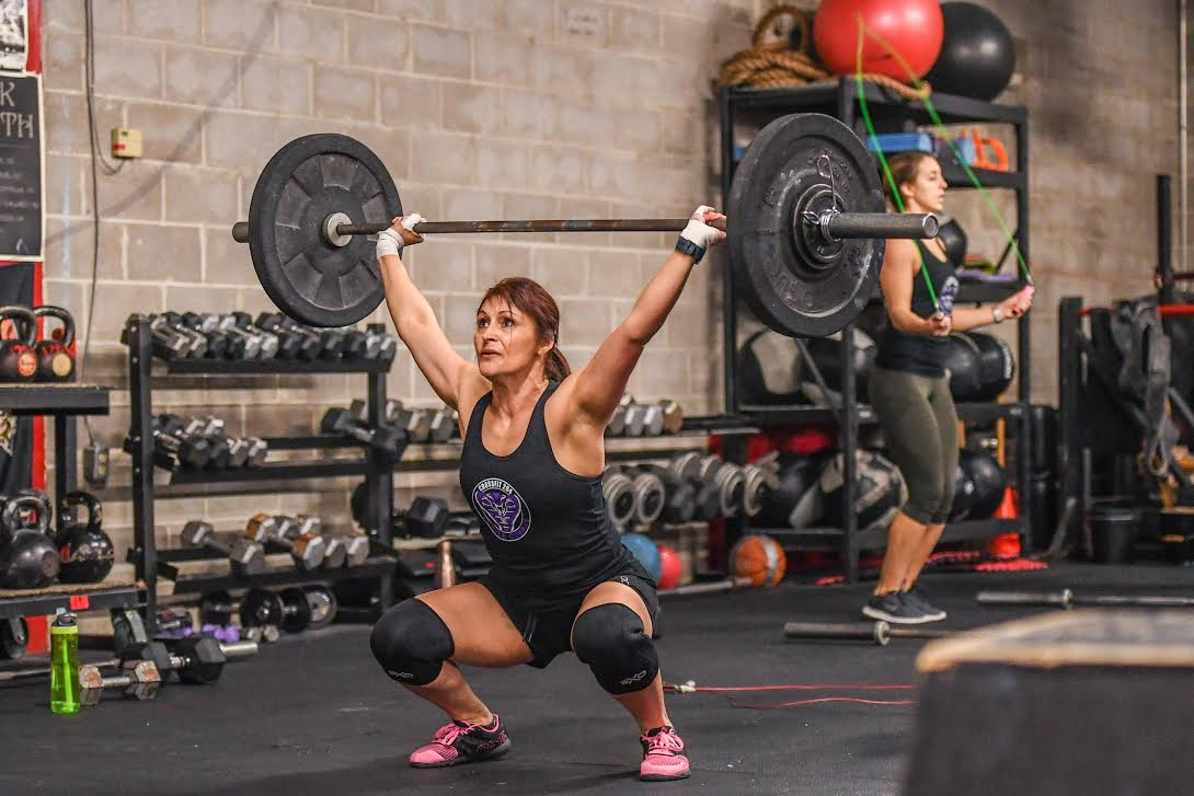 Woman overhead squatting in 18.3