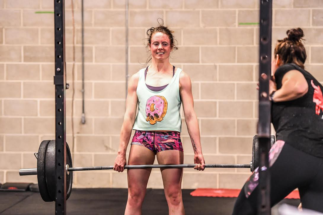 Deadlifting the barbell during 18.4