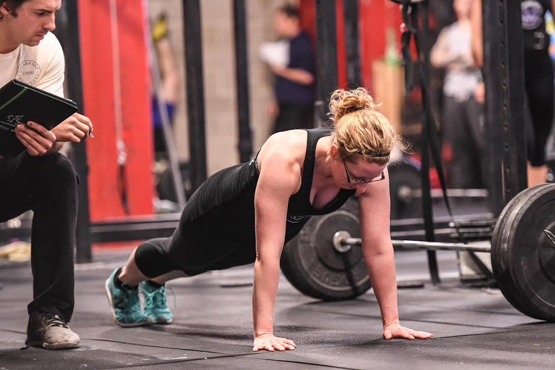 Athlete demonstrates good push-up form during (scaled) 18.4