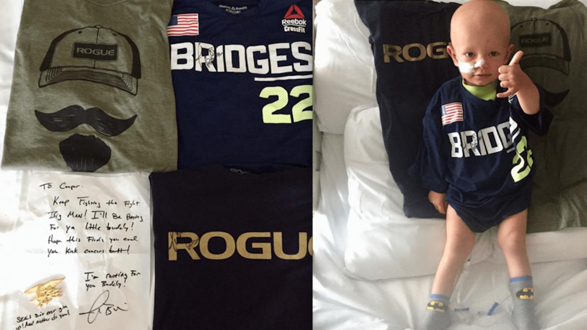 Little boy wearing his signed gear from Josh Bridges' care package.