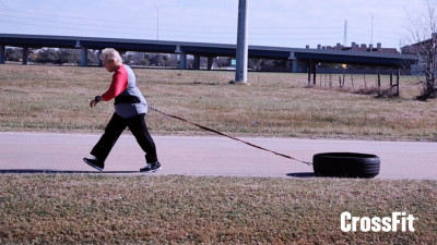 73-year-old woman pulling a tire