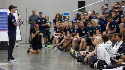 Boz giving an athlete brief