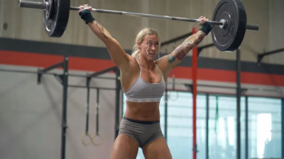 Danielle Brandon with barbell overhead