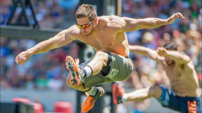 Dan Bailey jumping over hurdles