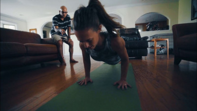 Athlete doing push-ups in living room