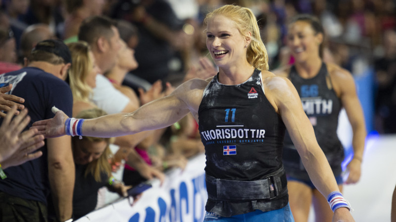 Annie Thorisdottir high fives a fan at the 2018 CrossFit Games