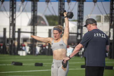 Adaptive athlete with dumbbell overhead