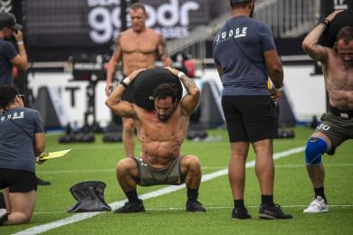 Masters athletes performing sandbag squats