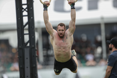 Sean Sweeney performing a muscle-up