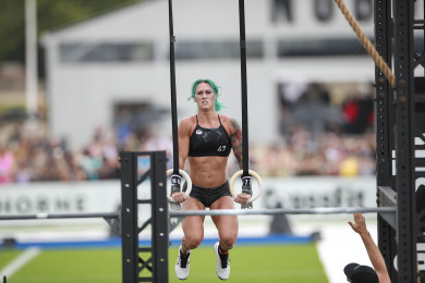Danielle Brandon performing a muscle-up