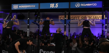Synchronized chest-to-bar pull-ups.
