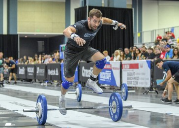 Adam Klink hurdles over his barbell toward the finish line.