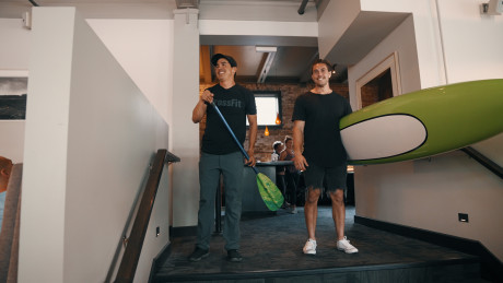 Dave Castro and Khan Porter announcing the paddle at the athlete dinner