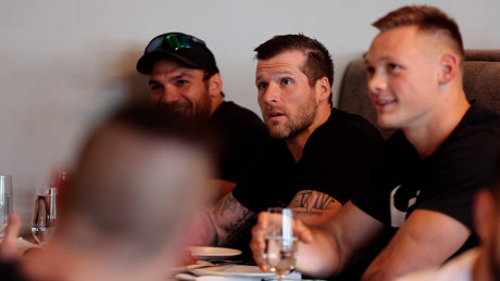 Travis Mayer (center) at the athlete dinner